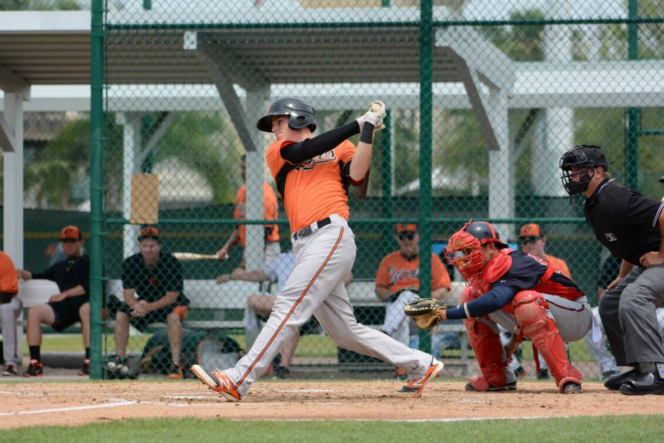 jonah heim batting for orioles with catcher and referee behind him