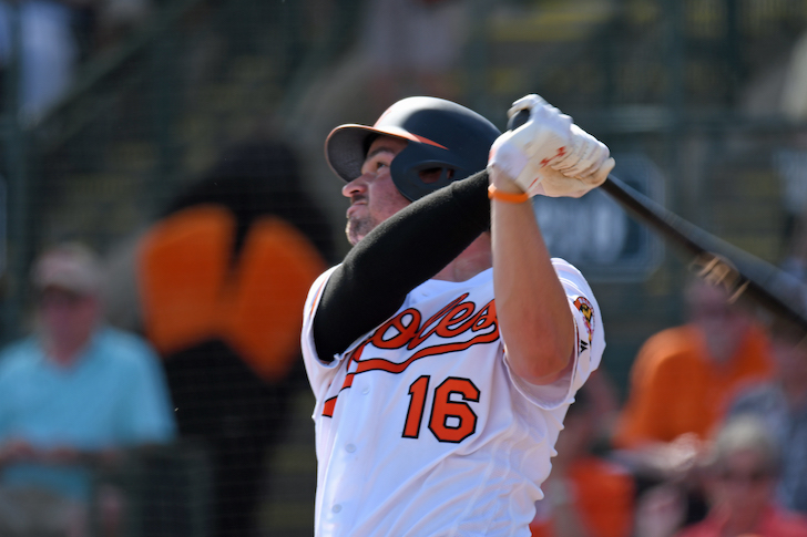 Trey Mancini watches the ball after making contact.