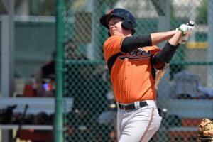 Ryan Mountcastle swings.
