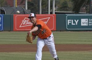 Keegan Akin throws a pitch