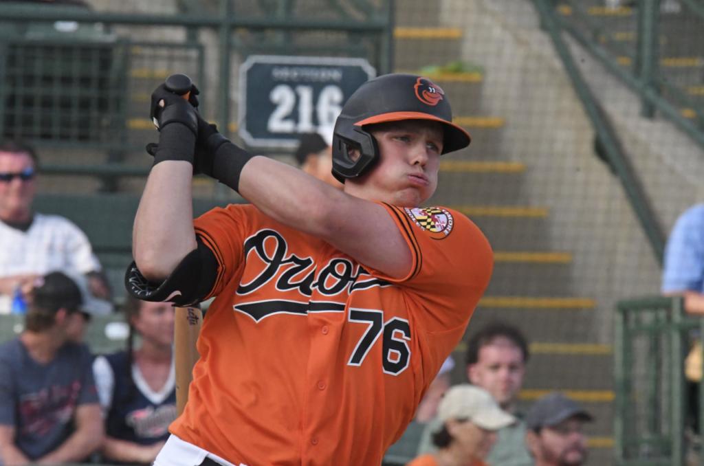Adley Rutschman swings in the batter's box